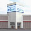 """A photo of the Webster ReStore with a banner across the building, reading """"Habitat for Humanity ReStore""""."""